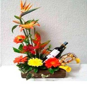 Arreglo floral en Botella de Vino Brindis