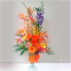 Arreglo Floral con Gerberas y Lirios Jade
